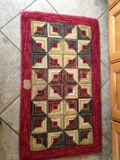 Log cab rug designed and hooked by Mary Pat Stickler