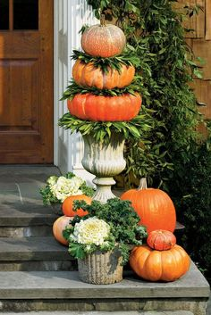 Pumpkin Topiary - Fabulous Fall Decorating Ideas - Southernliving. Vertical displays make a big statement at the front door. Tucking in cool-weather edibles such as ornamental flowering cabbages, kale, and bay leaves adds a distinctive twist. To create topiaries, sandwich bay wreaths between pumpkins stacked in concrete urns, and top with a small pumpkin.
