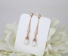 Long rose gold earrings, Long Bridal earrings, Art Deco earrings, Pearl drop earrings, Wedding jewelry, Freshwater pearl earrings, Vintage by TheExquisiteBride on Etsy https://www.etsy.com/listing/398932355/long-rose-gold-earrings-long-bridal