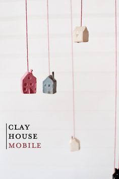 """""""Little Houses"""" Mobile. Sadly the link is a dead end, I would have liked to have seen the whole thing & how it was hung & from what. Still very nice idea though ;)"""