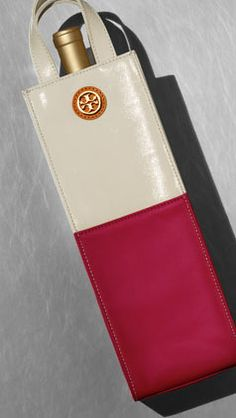 TB wine carrier... i want everything on the tory burch gift guide