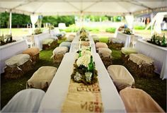 What a great idea for outdoor seating:  hay bales covered in fabric and knotted at the corners!