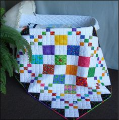 """CRIB SIZE: 39"""" x 45"""". DIAMOND PATCH QUILT PATTERN. This quilt goes together so fast. Especially good for a beginner or just someone that needs a quick baby gift OR just because you like it. I have added a supplement to the pattern of the quilt with the red border and the 9-Patch blocks on the outside by the border. 