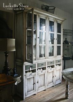 miss mustard seed - love the distressed finish of this hutch
