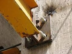 connecting steel beams to concrete columns - Google Search