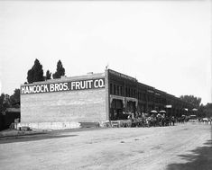 Hancock Bros. Fruit Company, July 30, 1910. This section of Pierpont Avenue between 200 and 400 West was home to a number of produce wholesalers. These buildings now house Artspace and the end wall visible here is the canvas for the city's most colorful exterior building mural.