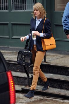 Taylor Swift looking fall-perfect with her cat Olivia Benson in tow