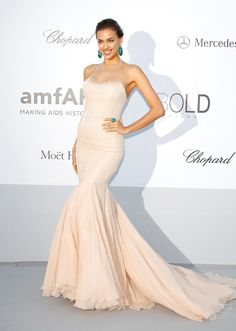 Shayk stunned in ivory and emerald jewelry the 2012 amfAR's Cinema Against AIDS in Cannes.