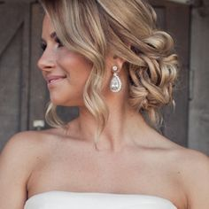 Two reasons to love this photo: 1, the gorgeous earrings, and 2, the beautiful updo! Both are perfect for a bride or bridesmaid!