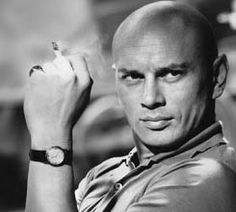 """Yul Brynner. I'm pretty sure he only had one expression... """"What do you mean? This IS my happy face!"""""""