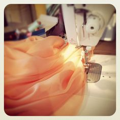 Rolled hems on circular silk skirts...