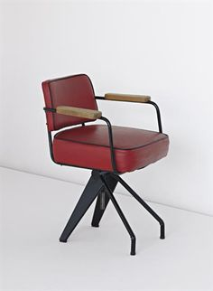 JEAN PROUVÉ Very rare swivelling office chair, special model, 1950  Painted bent sheet steel, painted tubular steel, vinyl, oak.  80 cm. (31 1/4 in.) high Manufactured by Les Ateliers Jean Prouvé, France.