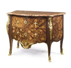 A LOUIS XV ORMOLU-MOUNTED BOIS SATINÉ, AMARANTH, FRUITWOOD AND MARQUETRY COMMODE CIRCA 1760, STAMPED P. GARNIER, PARTIALLY REMOUNTED Pierre Garnier (c.1720-1800), maître in 1742
