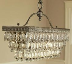 Antique style chandelier. Would be perfect over a long farmhouse table.