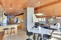 This midcentury gem by Carl Graffunder in Minneapolis has a concrete block wall, deep overhangs, large patio space, a second floor balcony and walls of glass.