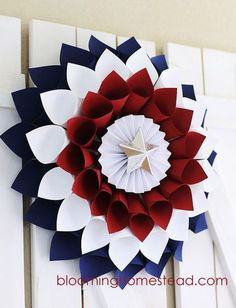 A (paper) firework gives guests an enthusiastic welcome. Just roll and glue cardstock for the perfect opening statement.  fourth-wreathClick through for more 4th of July decorations for celebration.