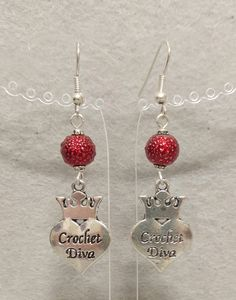 "Handme  Red glass beads  Tibetan silver ""crochet diva"" crown heart charms  Silver plated nickel free french wires  2"" long 