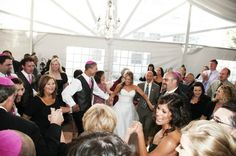 Hava, Negilah...havah! The horah at this festive modern jewish wedding. Photo by Two One Photography #mazeltov #hora #jewish #tradition