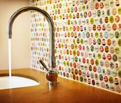 Bottle top back splash... would LOVE to do something like this in a bathroom, perhaps, but I am well aware that the only bottle tops we have around here are Bud Light. smh. Ooh- maybe in a basement man-cave??!! for the bar area?? ('cause what's a man cave without a bar??)