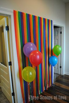 Photo booth backdrop using plastic tablecloths for a for How to make a balloon and streamer backdrop