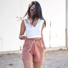 Pin for Later: 20 No-Fuss Summer Outfits That Take 2 Pieces or Fewer A Solid Cropped Tank Top and High-Waisted Shorts