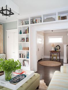 Create a Decorative and Hardworking Room Entry: Even on functional wall makeovers, the space adjacent to the ceiling is often ignored. This redo shows how to put that area to good use. To maintain visual continuity on a wall unit such as this, pick up on details—extra wide, white—from painted molding.