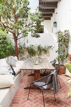 """California Cool - """"My number one tip for making an outdoor space feel comfy and stylish? Don't forget the outdoor rug, pillows, and throws,"""" says Garlough. """"They add character and color, and make a patio or deck feel so much more inviting. Backyard Patio, Backyard Landscaping, Backyard Ideas, Porch Ideas, Backyard Decorations, Landscaping Ideas, Patio Ideas Summer, Terraced Backyard, Backyard Privacy"""