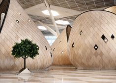 """Giant wooden """"cocoons"""" feature inside the new terminal at Baku airport in Azerbaijan."""