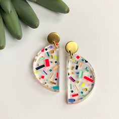 Set of bright and colorful hand painted clear acrylic geometric earrings. Earrings are nickel and lead free. Earring Dimensions:  2 inches long Made by an artist in Lafayette, Louisiana.