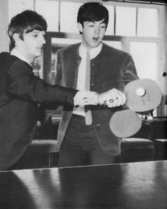 Paul and Ringo playing ping pong.