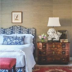 A lumbar pillow in a guest bedroom wears Travers' whimsical Samango linen print from George Cameron Nash, complementing the brand's Burchell material covering the Ferrell Mittman headboard. Prelle fabric pops on the bench from English Accent Antiques.