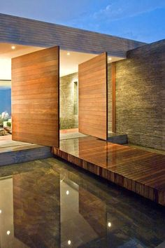 A modern entrance which has throwback features of a traditional mote. Designed by Alejandro Restrepo Montoya + Camilo Andrés Mejía Bravo + Andrés Felipe Mesa Trujillo Residential Architecture, Amazing Architecture, Contemporary Architecture, Interior Architecture, Amazing Buildings, Installation Architecture, Lobby Interior, Contemporary Homes, Diy Interior