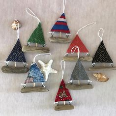 Driftwood and Fabric Sailboat Ornaments These drift wood ornaments can be used as nautical themed party, wedding, Christmas tree ornaments. They would be great for decorating a nautical or beach themed party or wedding. I used dried and clean driftwood with its natural color. Their sail
