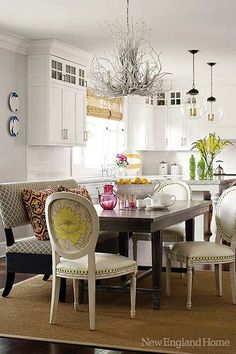 love this! the chandelier, the light fixtures over the island, the seating, the table!!