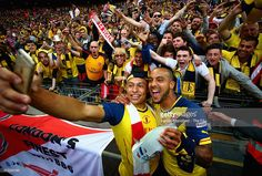 <a gi-track='captionPersonalityLinkClicked' href=/galleries/search?phrase=Alex+Oxlade-Chamberlain&family=editorial&specificpeople=7191518 ng-click='$event.stopPropagation()'>Alex Oxlade-Chamberlain</a> Theo Walcott of Arsenal take a selfie with their fans after winning the FA Cup Final between Aston Villa and Arsenal at ...