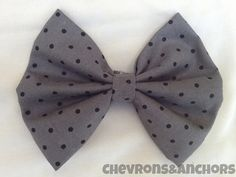 This is a gray & black polka dot bow. Perfect for your hair or to clip onto your purse!  This bow measures 4 inches x 5 inches.  All bows come on a double prong alligator clip.