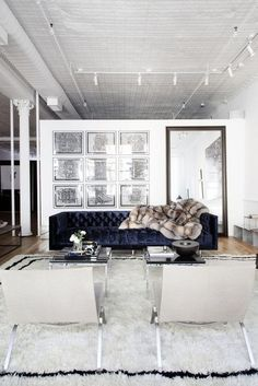 velvet couch in navy - line of same navy in rug-  but above all- the gorgeous opulence of that throw