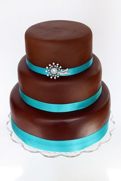 Chocolate Wedding Cake With Teal Ribbon. I think she'd change out the teal for coral!