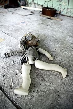 With sadness...doll with gas mask in Pripyat...victim of Chernobyl nuclear disaster, Ukraine