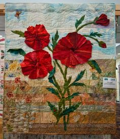 """Field of Poppies"" by Amie Spinello at A Quilters Gathering 2011 show"