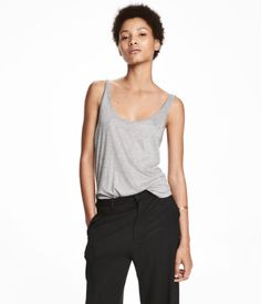 Gray melange. Wide-cut tank top in soft viscose jersey with a slight sheen. Rounded hem.