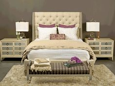 tufted headboard and silver accents on furniture