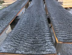 The wood is carefully charred, doused in water and cooled. Once cooled, it's brushed to remove the dust and loose debris, and then cleaned, meaning washed and dried. The shou-sugi-ban can either be finished with a natural oil or left as is. Shou-sugi-ban… I'm in Love!