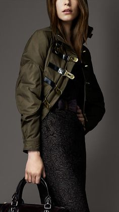 BURBERRY   -   Sophisticated bomber jacket in a warm cotton gabardine  Striking leather and polished metal twist lock closure  Stand collar and elbow patches give an elevated military finish