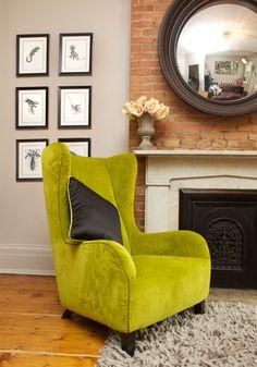 Lime green velvet Natuzzi wing chair and Mauricio Ortiz Animalia prints.