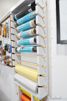 Vinyl Roll Storage Rack Organize your craft vinyl so it's always on hand with this vinyl roll storage rack. This easy to build storage solution is made from inexpensive Paint Storage, Craft Room Storage, Storage Ideas, Diy Vinyl Storage Rack, Craft Storage Solutions, Sewing Room Organization, Office Organization, Organization Quotes, Diy Rangement