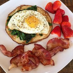 """""""And how I do crepes  top them with sautéed spinach, a free range crispy fried egg with adobo then add some bacon and organic strawberries. Amazing!  #paleobreakfast #paleocrepes #yolkporn #organic"""" Photo taken by @paleohope on"""