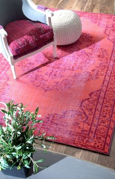 Overdyed pink area rug