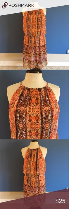 """London Times Orange Printed Dress You just found your vacation dress!  The halter style is classy and """"hip"""".  Elastic waist for the perfect fit. No slit. Keyhole Back. Lined.  Measurements:  Length - 39""""/Bust - 20""""/Waist - 18"""" London Times Dresses Midi"""