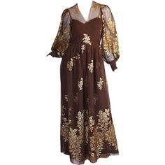 Pre-owned 1970s Haute Couture Yves Saint Laurent Metallic Dress ($4,000) ❤ liked on Polyvore featuring dresses, evening dresses, sheer sleeve dress, see through dress, special occasion dresses, sexy sheer dresses and puff sleeve dress